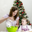 Little girl and mother are preparing Christmas cookies — Stock Photo #7797801
