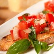 Bruschetta with tomato, mozzarella and basil - Stock Photo