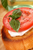 Bruschetta with tomato, mozzarella and basil — Stock Photo