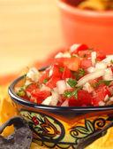 Delicious fresh pico de gallo salsa and chips — Stock Photo