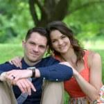 Young couple in a summer garden — Stock Photo