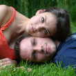 Couple Lying on Grass — Stock Photo #29562205