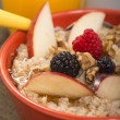 Oats with fresh fruit — Stock Photo