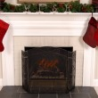 White fireplace decorated for Christmas — Stock Photo #5978768