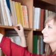 Serious student takes the book in the library — Stock Photo