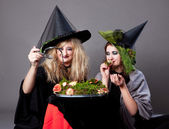 Halloween party - girls in costumes of witches — Stock Photo