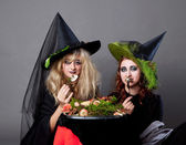 Halloween party - women in costumes of witches — Stock Photo