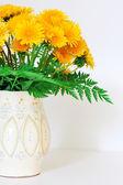 Dandelions in a clay vase — Stock Photo