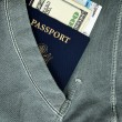 Passport with money and boarding pass — Stock Photo