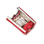Red opened purse with silica gel — Stock Photo