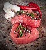 Raw steaks — Stock Photo