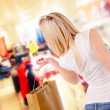 Beautiful blond girl shopping — Stock Photo
