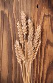Wheat on wood — Stock Photo