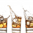 Splashing whiskey — Stockfoto