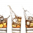 Splashing whiskey — Stock fotografie