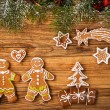 Gingerbread happy creatures on wood — Stock Photo