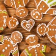 Gingerbread happy creatures on wood — Zdjęcie stockowe