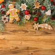 Gingerbread on fir tree branches — Stock Photo