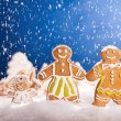 Christmas gingerbread with falling snow — Stok fotoğraf