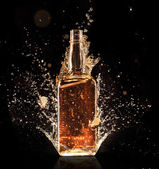 Splashing whiskey — Stock Photo
