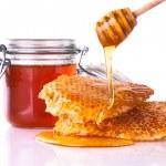 Honey with honeycomb, isolated on white background — Photo
