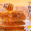Stock Photo: Honey in jar with honeycomb and wooden drizzler