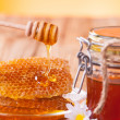 Stock Photo: Honey with honeycomb and wooden drizzler