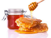 Honey with honeycomb, isolated on white background — Stock Photo