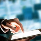 Man hand touching the screen — Stockfoto