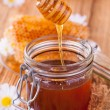 Still life of honey on wooden table — Photo