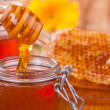 Still life of honey on wooden table — Stock fotografie