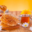 Still life of honey on wooden table — Stockfoto