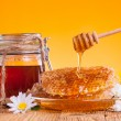 Still life of honey on wooden table — Stok fotoğraf