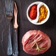Fresh raw beef steak on black stone — Foto Stock