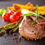Filete de carne fresca en piedra negra — Foto de Stock   #41864973