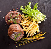 Fresh beef steak on black stone — Foto Stock