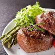 Fresh beef steak on black stone — ストック写真