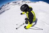 Alpine skier on piste, skiing downhill — Stock Photo
