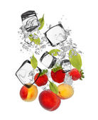 Fresh fruit falling in water splash — Stock Photo