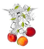 Fresh nectarines falling in water splash — Стоковое фото