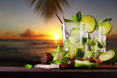 Fresh mojito cocktails on beach — Stock Photo