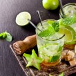 Fresh mojito drinks on black stone — Stock Photo #45061235
