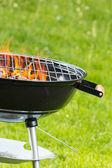 Empty grill on garden — Stock Photo