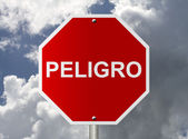 Stop Sign with word Peligro, Danger — Stock Photo
