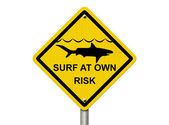Use caution when surfing because sharks are present — 图库照片