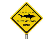 Use caution when surfing because sharks are present — Foto Stock
