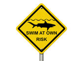 Use caution when swimming because sharks are present — ストック写真