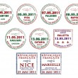 Passport stamps from Italy, Malta and France - Stock Photo
