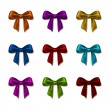 Set of elegant silk colored bows — Stock Vector