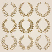 Set of Vector gold laurel wreaths. — Stock Vector